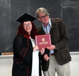 Linguistics student receiving diploma