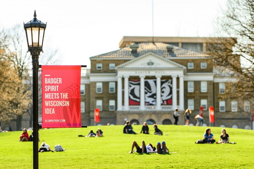 Students sitting on Bascom Hill in Spring