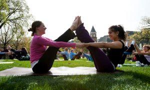 Students doing yoga making 'W' shape